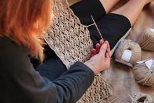 Woman Crocheting A Natural Lin...