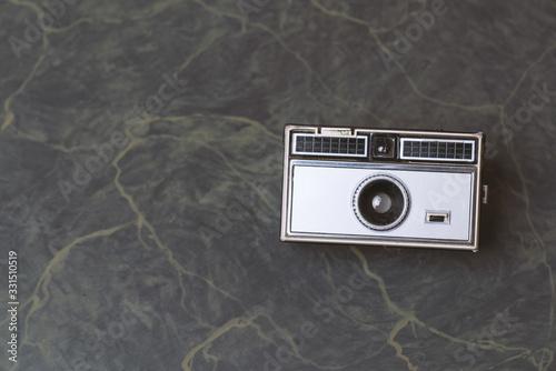 Retro classic 35mm photo camera on Background Canvas Print