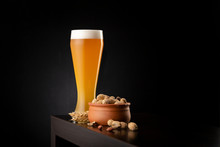 Cold Unfiltered Wheat Beer And Peanuts