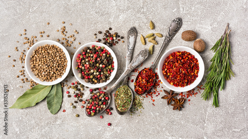 Tela Different spices, dry kitchen herbs and seeds for tasty meals