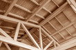 canvas print picture - The construction of the wooden roof. Detailed photo of a wooden roof overlap construction.