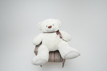 White Teddy Bear In Chair. Iso...
