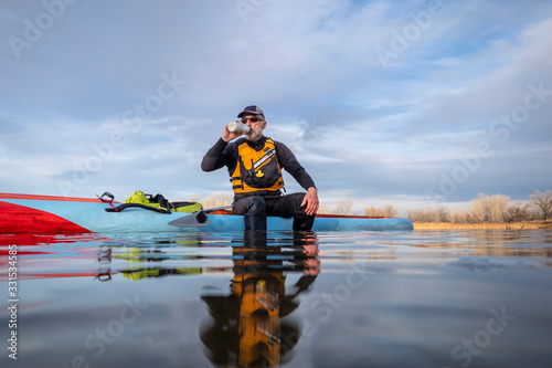 Obraz senior male with stand up paddleboard - fototapety do salonu