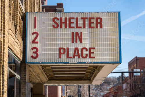 Movie cinema billboard with Shelter in Place message to avoid the coronavirus epidemic. - 331541527