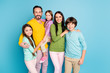 canvas print picture - Portrait of nice attractive lovely charming ideal glad cheerful cheery family schoolkids mommy daddy embracing spending day daydream isolated on bright vivid shine vibrant blue color background