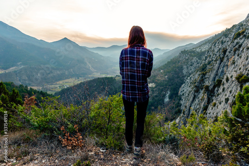 A full body shot of a young female hiker / adventurer in the French Alps mountai Canvas Print