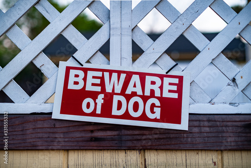 beware of guard dog sign on wooden gate Canvas Print