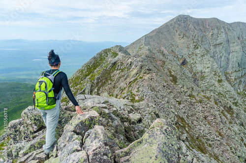 Obraz Woman hiking along Knife Edge Trail of Mount Katahdin Northeast Piscataquis Maine USA - fototapety do salonu