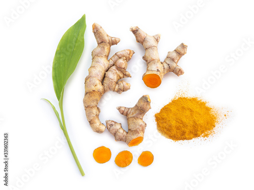 Fototapeta turmeric powder and turmeric rhizome and slice or curcuma longa with leaf and use as ingredients cosmetics products and is a anti inflammatory and antioxidant, including is a herb use for health care. obraz