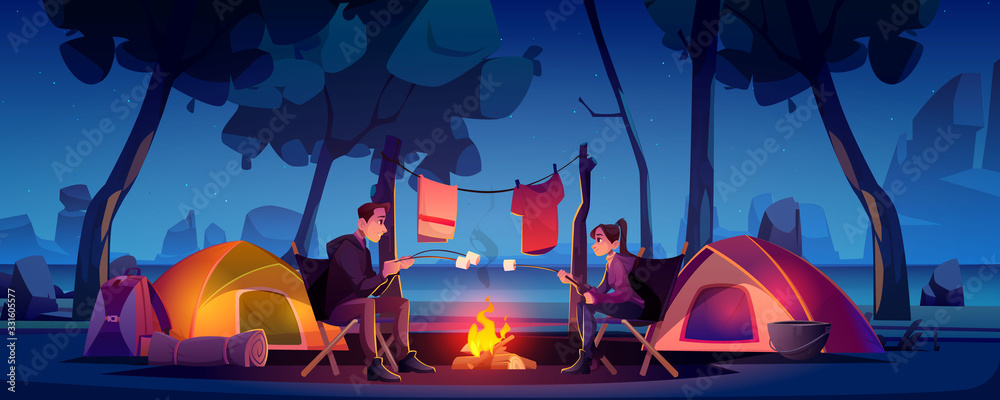 Fototapeta Summer camp with couple, tent and campfire at night. Vector cartoon landscape of two people in natural parkland, countryside with lake and mountains on background. Picnic on river beach