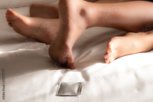 Photo Condom ready to use on the bed for safe sex concept to prevent infection and contraceptives control the birth rate or safe prophylactic