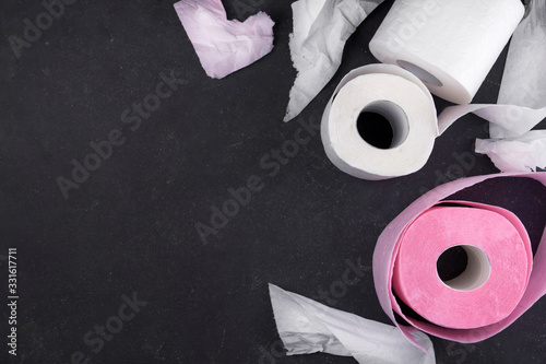 Obraz na plátne .Rolls of white and pink toilet paper flat lay. Pieces of torn toilet paper on a