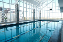 Modern Swimming Pool With Clean Water And Lane Divider In Health Club, Sport And Spa Concept