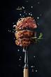Leinwandbild Motiv Grilled ribeye beef steak with rosemary and salt.