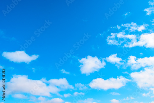 White, airy clouds on a blue sky Canvas Print