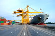 Leinwandbild Motiv Logistic system on transportation with giant crane working unload container from cargo ship on terminal, import and export on shipping
