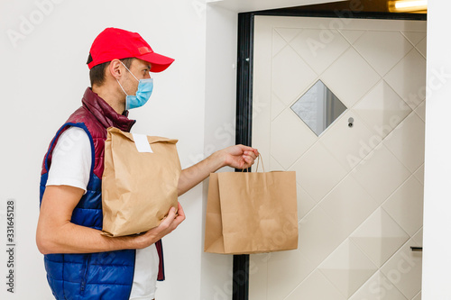 Delivery man holding paper bag with food on white background, food delivery man Wallpaper Mural