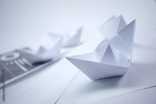 Photo business concept - paper boats on the documents