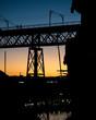 Colorful city bridge at sunset
