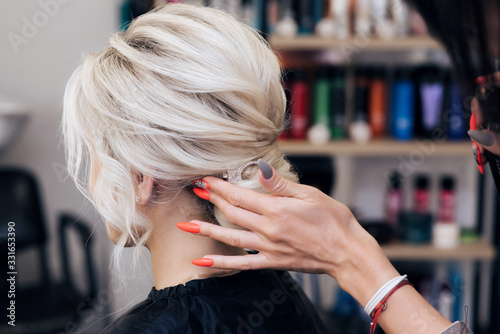 hairstyle bun for a blonde girl with long hair