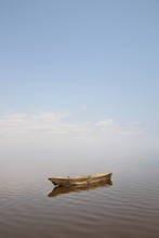 Serene Boat On Still Lake