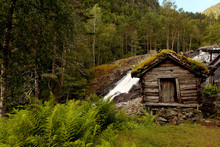 Very Old Watermills With Grassy Roofs In Norway