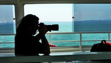 Photographer In The Boat