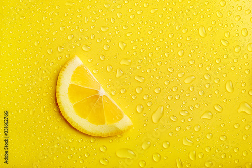 Fototapeta Lemon slice on yellow background obraz