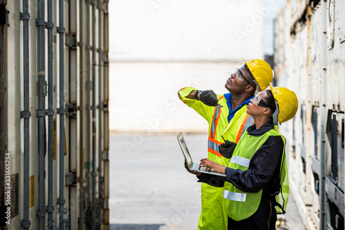 Fototapeta  Professional engineer staff team checking and inspect container for international business logistic import and export concept.  obraz