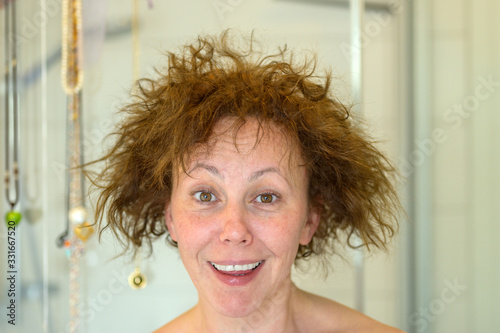 Fototapeta Charismatic laughing woman having a bad hair day obraz