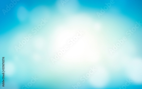 Photo A blurred fresh cool, spring and summer blue sky abstract background with bokeh glow