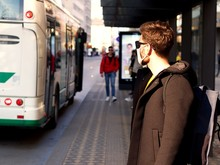 Man Wearing FFP3 Face Protection Mask, Since New Coronavirus Sars-CoV-2 And A Flu Have Emerged Waiting At The City Bus.