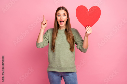 Astonished crazy girlfriend hold big red paper card heart get wonderful idea her Wallpaper Mural