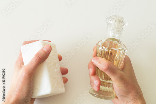 Photo hand and body care with soap and cologne for corona virus.