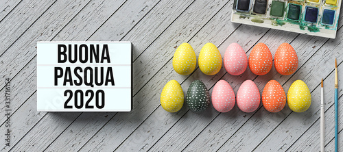 Leinwand Poster easter eggs with message HAPPY EASTER 2020 in Italian and lightbox with number 2