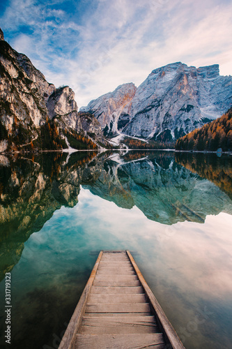 Obraz Amazing view of Lago di Braies (Pragser Wildsee), most beautiful lake in South Tirol, Dolomites mountains, Italy. Popular tourist attraction. Beautiful Europe. - fototapety do salonu