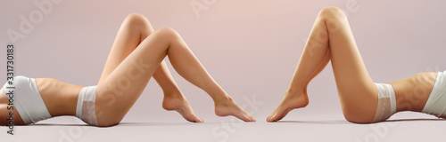 Female legs on white background