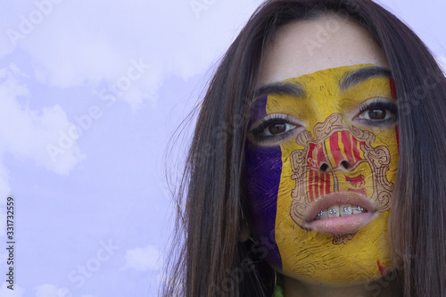 Flag of Andorra painted on a face of a smiling andorran young woman Wallpaper Mural