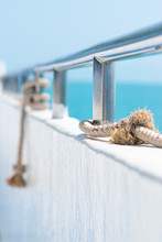 Ship Railing With Rope And Blue Sea