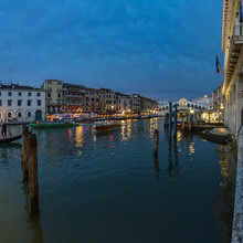 VENICE, ITALY - August 02, 2019: View From Rialto Bridge In Venice At Sunset Time. Venetian Grand Canal With Historical Buildings, Hotels, Tourist Boats, Piles, Berths. Fish Eye Lens Shot