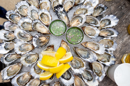 Photo 50 Oysters on a platter - with lemons and vinaigrette