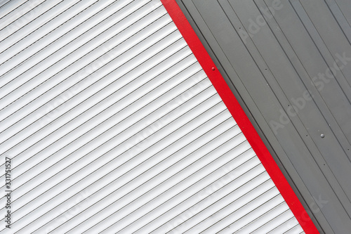 Photo Abstract view of white, red nad grey anti-theft shutters