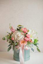 A Large Flower Arrangement In A Hat Box Was Created By A Florist For A Wedding Gift. Hydrangea, Amarallis, Roses And Eucalyptus In A Bouquet