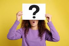 African-American Woman With Question Mark Sign On Yellow Background