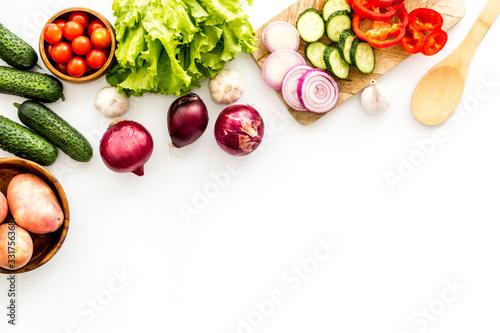 Fototapeta Autumn harvest. Vegetables - potato,cucumber, corn, greenery - frame on white background top-down copy space obraz