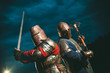 canvas print picture - Two Medieval knights armed with axe and sword.
