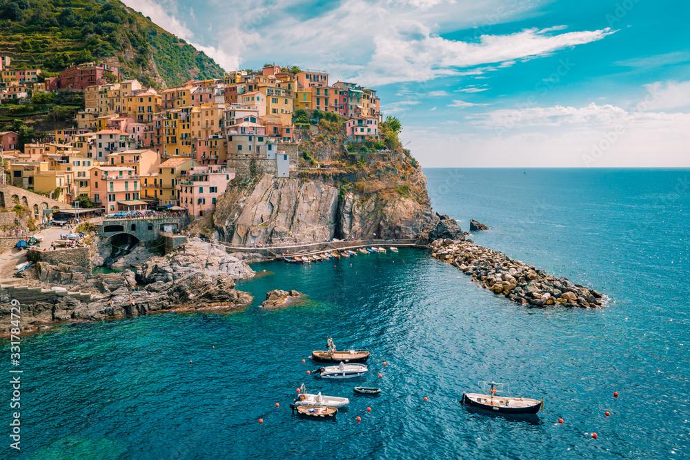 Fototapeta Manarola Village, Cinque Terre Coast Italy. Manarola is a beautiful small colorful town province of La Spezia, Liguria, north of Italy and one of the five Cinque terre national park