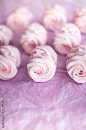 Homemade pink marshmallows on pastel pink background. Creative concept Marshmallow, Meringue. Homemade Sweets dessert © Iryna