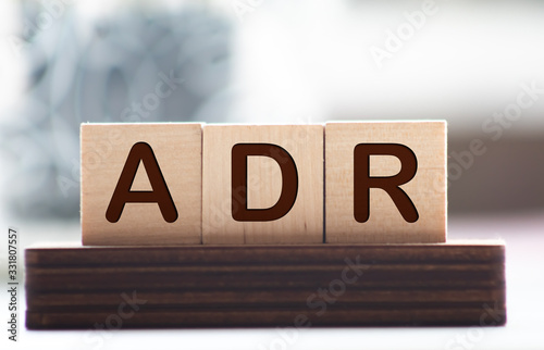 Letter block in word ADR Abbreviation of adverse drug reaction on wood backgroun Canvas Print