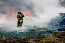 Two Firefighters Containing Th...